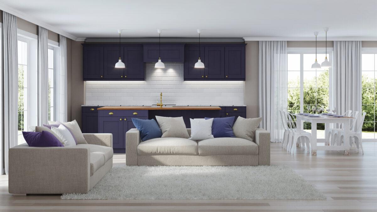 Mondern interior of a home, white sofa with purple kitchen