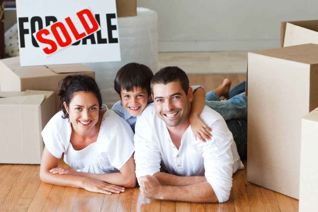 Princing Your Property to Sell - Happy Family with Sold sign background