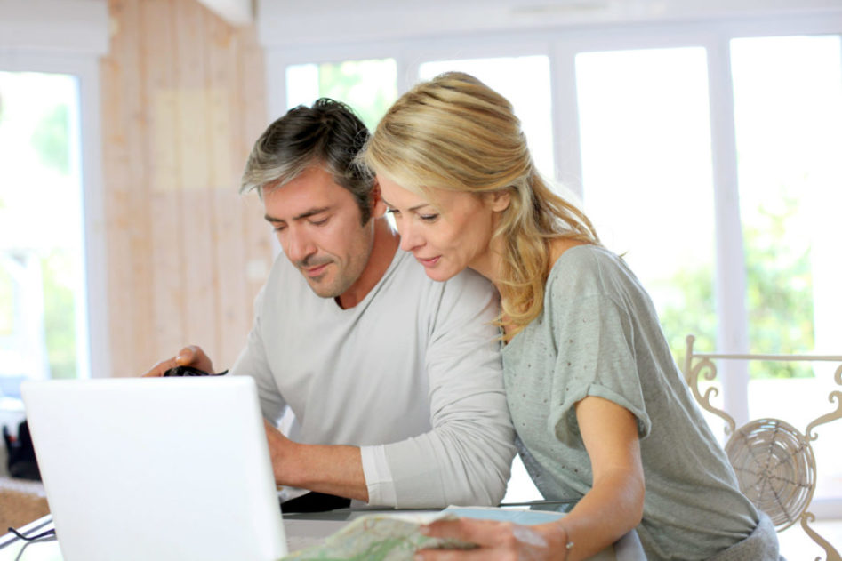 Mature couple reading Ten Step to Buying a Home
