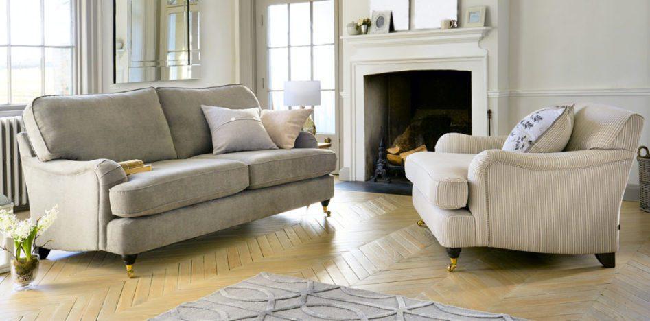 light colored sofa on hard wood floor in luxury home