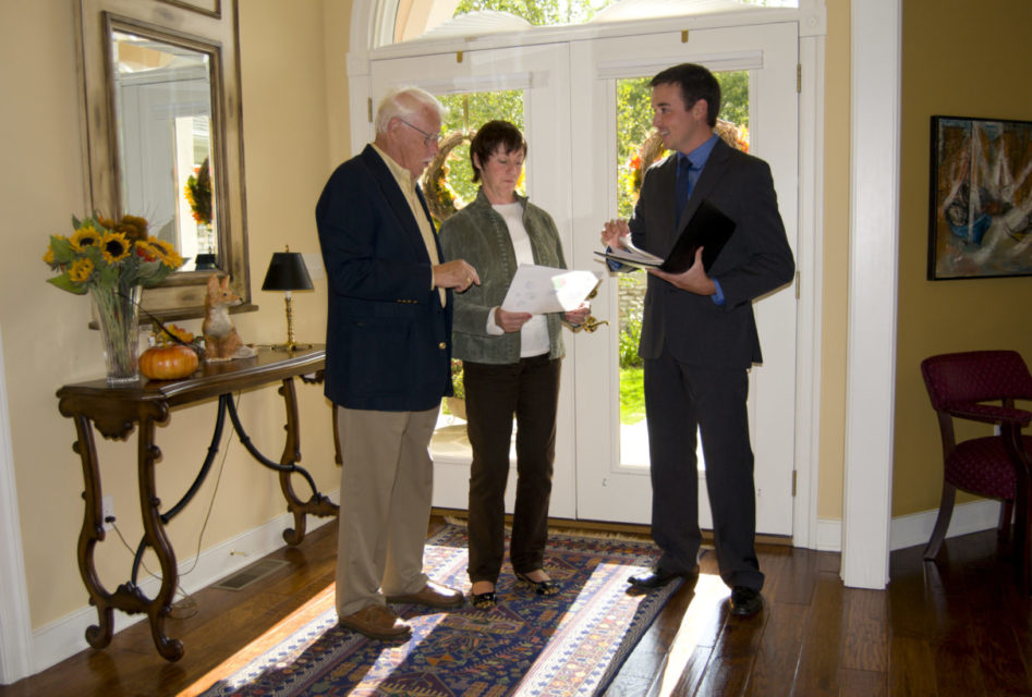 realtor showing a home to a senior couple