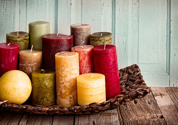 A colorful collection of decorative candles to give any room a fresh scent and a pop of color