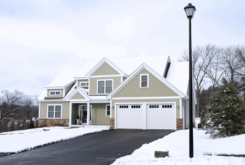 Homeowner tips, are heated driveways worth it. Home and driveway in the winter.