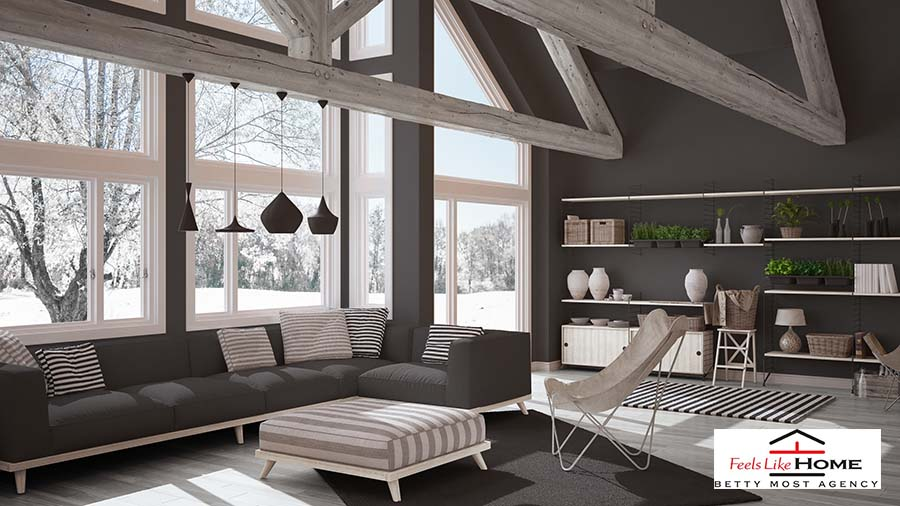 Open space home with large front windows in the winter