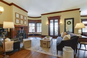 Summit Hill Property, interior, beautiful classic wood panel around fireplace. Gorgeous room