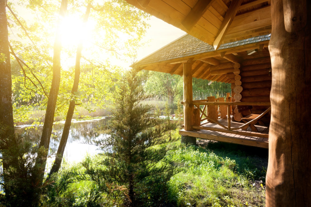 Beautiful log cabin on lakefront property on a sunny day