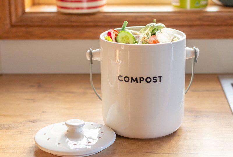White ceramic pot with vegetable compost scraps