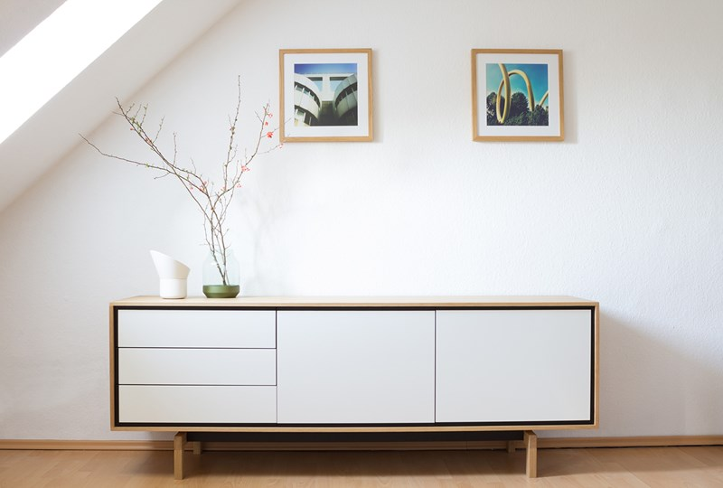 Mid-Century Modern Design , white and wood credenza against white wall