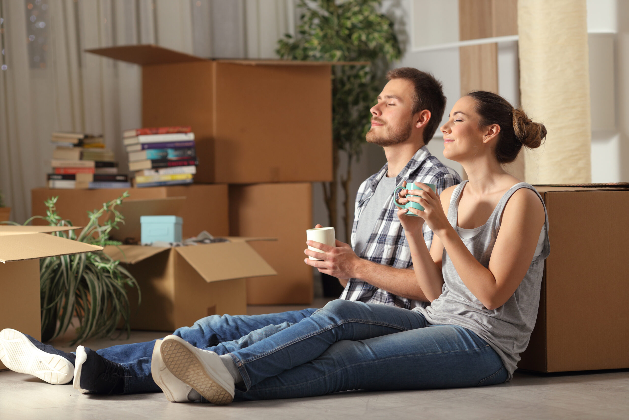 New homebuyers resting against moving boxes
