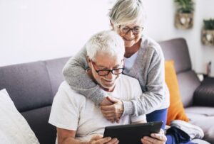 Senior couple on computer looking at two homes