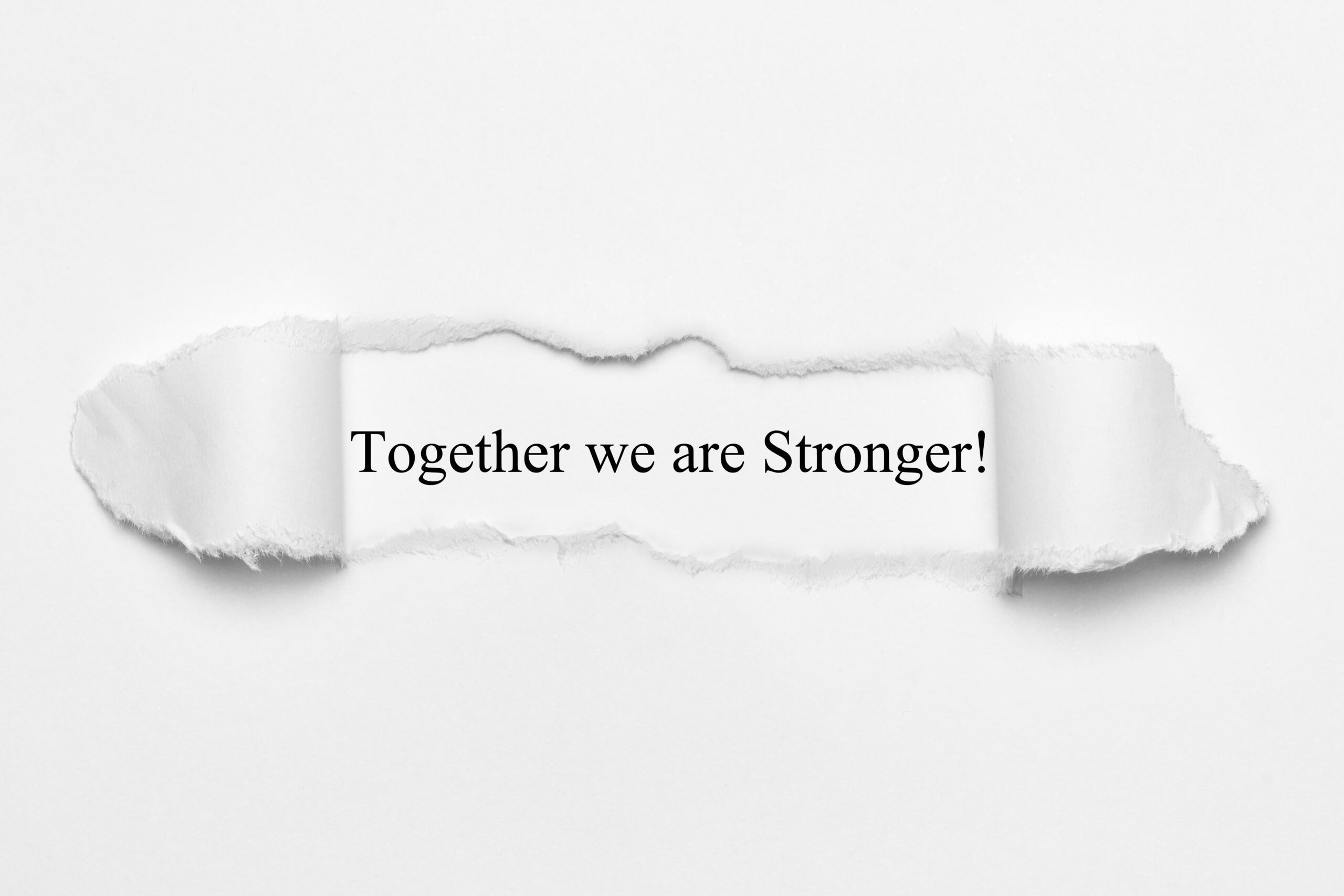 White paper, torn open - together we are stronger