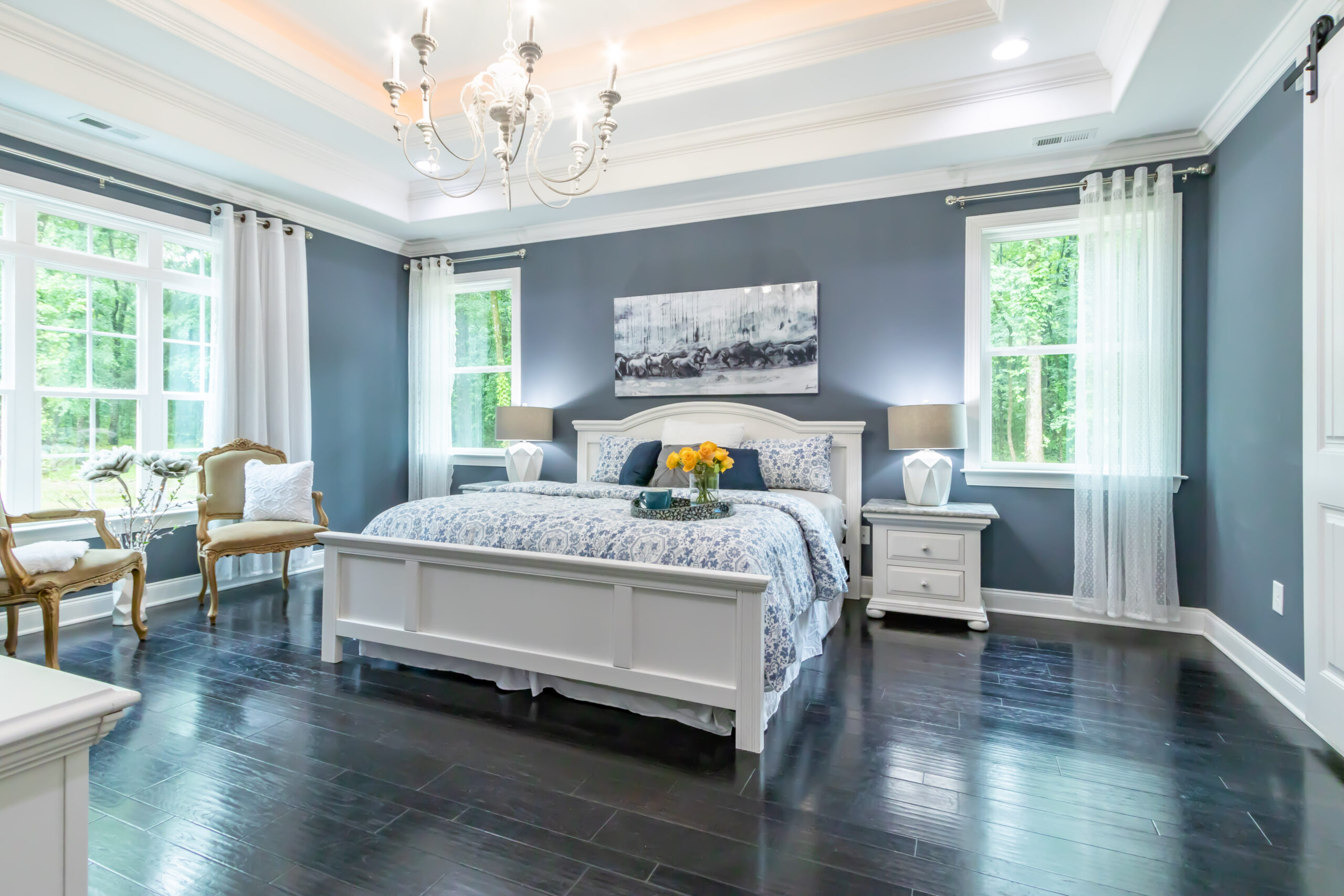 Beautiful interior design of bedroom with painted light grey walls - article decoding common paint terms.