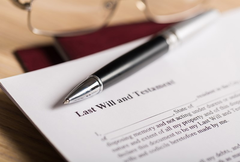 Silver and black pen on top of will, learn what to do if you inherit real estate property