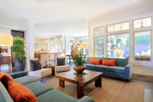 stylish living room with hardwood flooring and open space with windows.