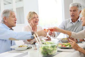 Four senior citizens having dinner