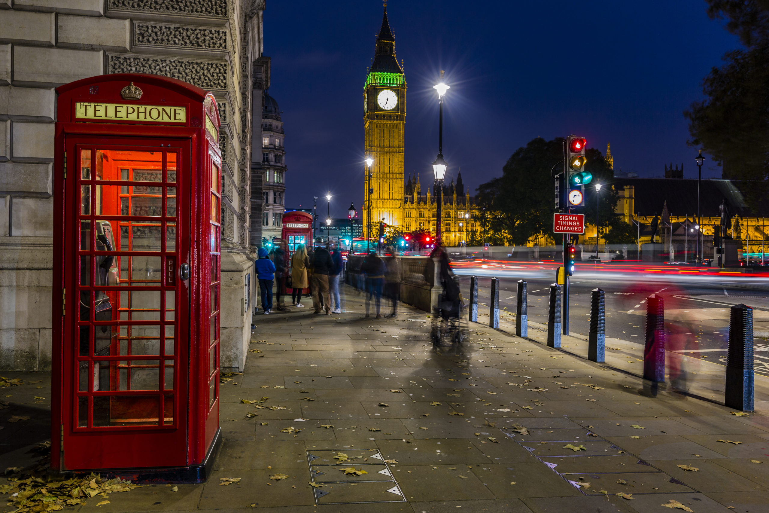 Red telephone box on street in London, contact us